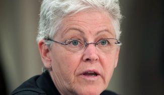 ** FILE ** In this Feb. 28, 2014, file photo, EPA Administrator Gina McCarthy discusses proposed regulations with coal industry leaders at Dakota Gasification Synfuels Plant in Beulah, N.D. (AP Photo/Kevin Cederstrom, file)