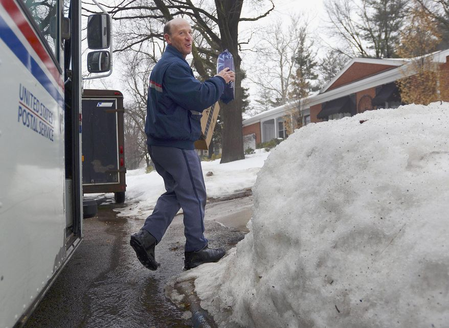 ADVANCE FOR USE SUNDAY, MARCH 9 AND THEREAFTER - In this Feb. 20, 2014 photo, U.S. Postal Service letter carrier Gary Keist prepares to make a delivery to a home in Normal, Ill. Keist, 56, began as a letter carrier in 1978 and said this winter is the worst he's ever worked because of the consistent pattern of snowfalls followed by bitterly cold temperatures with little or no break. (AP Photo/The Pantagraph, Steve Smedley)