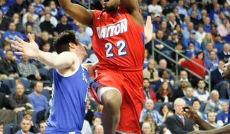 Dayton's Kendall Pollard (22) goes to the basket as Saint Louis' Tanner Lancona defends during the first half of an NCAA college basketball game Wednesday, March 5, 2014, in St. Louis. (AP Photo/Scott Kane)