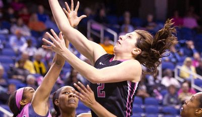 Wake Forest's Jill Brunori (2) goes for the layup between Pittsburgh's Chelsea Welch, left, and Marquel Davis during the 2014 ACC Women's Basketball Tournament at the Greensboro Coliseum, on Wednesday, March 5, 2014, in Greensboro, N.C. (AP Photo/News & Record, Joseph Rodriguez)