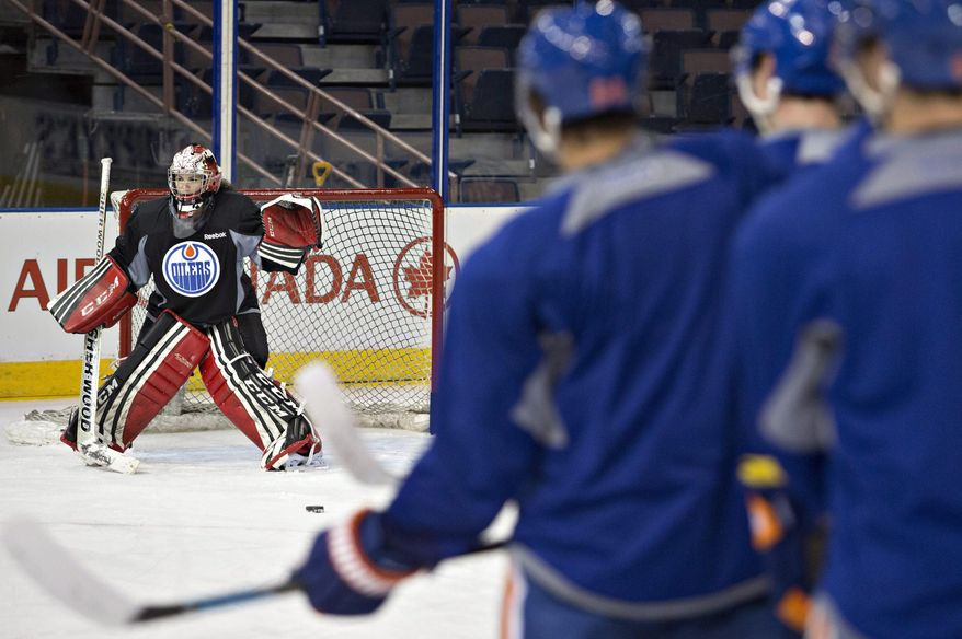 Canadian Olympic women's team goalie Shannon Szabados practices with the Edmonton Oilers NHL hockey team in Edmonton, Alberta, Wednesday, March 5, 2014.  (AP Photo/The Canadian Press, Jason Franson)