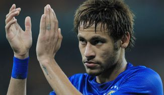 Brazil's Neymar, acknowledges fans during their international friendly soccer match against South Africa during their international friendly soccer match at Soccer City Stadium in Johannesburg, South Africa, Wednesday, March 5, 2014. Brazil beat South Africa 5-0. (AP Photo/Themba Hadebe)