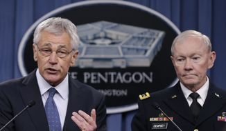 Defense Secretary Chuck Hagel, accompanied by Joint Chiefs Chairman Gen. Martin Dempsey, briefs reporters at the Pentagon, Monday, Feb. 24, 2014, where he recommended shrinking the Army to its smallest size since the buildup to U.S. involvement in World War II in an effort to balance postwar defense needs with budget realities. (AP Photo/Carolyn Kaster)