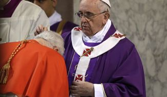 A Cardinal is sprinkled with ashes by Pope Francis during the Ash Wednesday mass at the Santa Sabina Basilica in Rome, Wednesday, March 5, 2014. Ash Wednesday marks the beginning of Lent, a solemn period of 40 days of prayer and self-denial leading up to Easter. (AP Photo/Max Rossi, Pool)