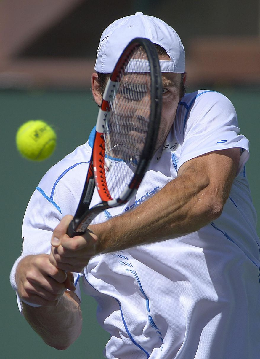 Benjamin Becker, of Germany, returns a shot against Edouard Roger-Vasselin, of France, during a first round match at the BNP Paribas Open tennis tournament, Thursday, March 6, 2014, in Indian Wells, Calif. (AP Photo/Mark J. Terrill)
