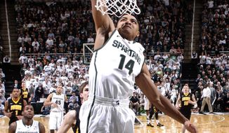 Michigan State's Gary Harris (14) goes up for a dunk against Iowa during the first half of an NCAA college basketball game, Thursday, March 6, 2014, in East Lansing, Mich. (AP Photo/Al Goldis)