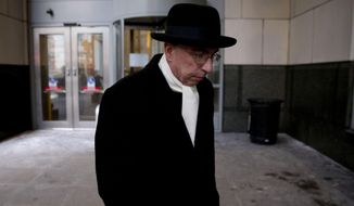 The Rev. Andrew McCormick walks from the center for criminal justice Thursday, March 6, 2014, in Philadelphia.  The Roman Catholic priest accused of molesting an altar boy briefly took the stand Wednesday to deny the 1997 encounter, but acknowledged being reprimanded twice for having children in his private living quarters. (AP Photo/Matt Rourke)