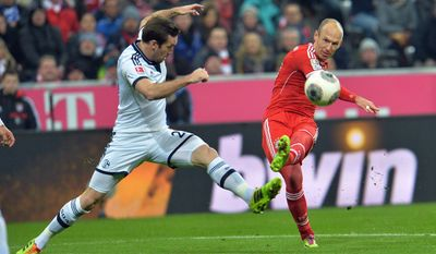 Bayern's Arjen Robben of the Netherlands, right, and Schalke's Christian Fuchs of Austria challenge for the ball, during  the German first division Bundesliga soccer match between  FC Bayern Munich and FC Schalke in Munich, Germany, on Saturday, March 1, 2014. (AP Photo/Kerstin Joensson)