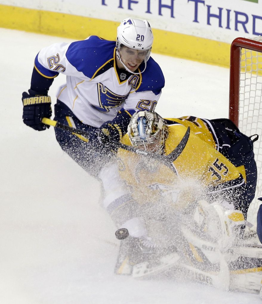 Nashville Predators goalie Pekka Rinne (35), of Finland, blocks a shot by St. Louis Blues left wing Alexander Steen (20) in the second period of an NHL hockey game Thursday, March 6, 2014, in Nashville, Tenn. Steen was given a penalty shot on the play. (AP Photo/Mark Humphrey)