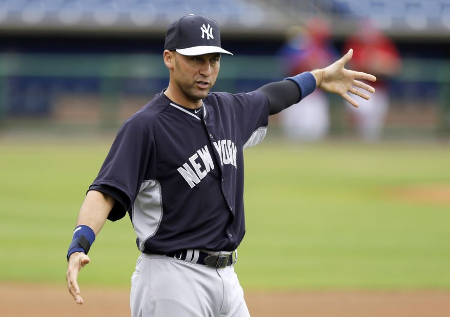 New York Yankees shortstop Derek Jeter stretches before an exhibition baseball game against the Philadelphia Phillies, Thursday, March 6, 2014, in Clearwater, Fla. (AP Photo/Charlie Neibergall)