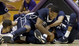 Penn State center Jordan Dickerson, center, battles for a loose ball against guard Tim Frazier, right, and Northwestern guard Drew Crawford, left,  during the first half of an NCAA college basketball game in Evanston, Ill., on Thursday, March 6, 2014. (AP Photo/Nam Y. Huh)