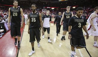 Purdue's A.J. Hammonds (20), Raphael Davis (35), Travis Carroll (50) and Ronnie Johnson walk off the court after the team's 76-70 loss to Wisconsin in an NCAA college basketball game Wednesday, March 5, 2014, in Madison, Wis. (AP Photo/Andy Manis)