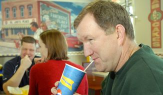 Milt Tandy sips a soft drink during lunch on a Friday during Lent at a Long John Silver's restaurant in Louisville, Ky. The dining choice was a testament to Mr. Tandy's Catholic faith, which forbids eating meat on Fridays during Lent. (Associated Press)