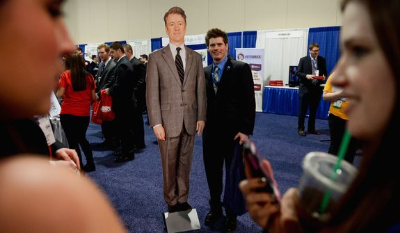 Keith Metz steps up to get his photo taken with a life-size cutout of Sen. Rand Paul, Kentucky Republican.
