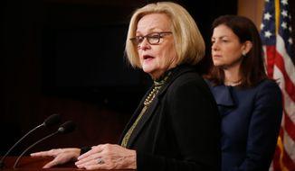 Sens. Claire McCaskill, Missouri Democrat (left), and Kelly Ayotte, New Hampshire Republican, speak at a Washington news conferemce Thursday. (Associated Press)