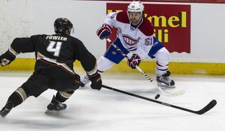 Anaheim Ducks defenseman Cam Fowler (4) and Montreal Canadiens center David Desharnais (51) vie for the puck during the first period of an NHL hockey game, Wednesday, March 5, 2014, in Anaheim, Calif.  (AP Photo/Ringo H.W. Chiu)