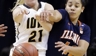 Illinois guard Amber Moore, right, knocks the ball away from Iowa guard Melissa Dixon in the second half of an NCAA college basketball game in the opening round of the Big Ten Tournament in Indianapolis, Ind., Thursday, March 6, 2014. Iowa won 81-62. (AP Photo/Michael Conroy)