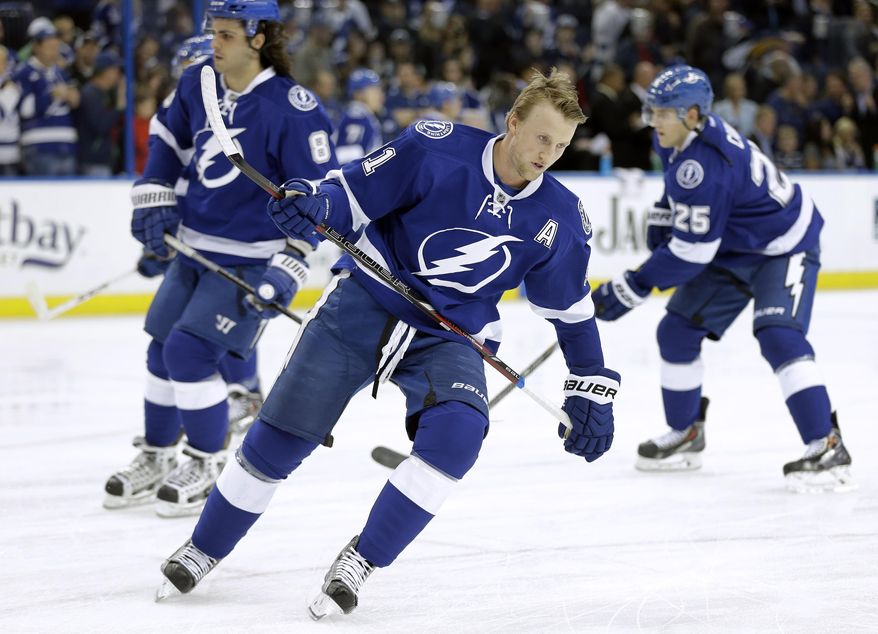 Tampa Bay Lightning center Steven Stamkos (91) skates during warm ups before an NHL hockey game against the Buffalo Sabres Thursday, March 6, 2014, in Tampa, Fla. Stamkos will be playing his first game since breaking his right tibia on Nov. 11, 2013 in Boston. (AP Photo/Chris O'Meara)