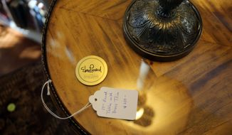 Thursday March 6, 2014, was  the first day of the estate sale at Elmore Leonard's home at 2192 Yarmouth in Bloomfield Township, Mich. The sale was  organized and run by his family members. Most of the items for sale have a gold sticker with Elmore Leonard's name on it.  (AP Photo/Detroit Free Press, Regina H. Boone)