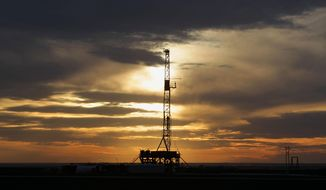"This Feb. 17, 2014 photo shows a drilling rig in Howard county, Texas as the sun sets. The federal Occupational Safety and Health Administration keeps a list of ""the worst of the worst"" employers in the nation and drilling companies with multiple fatalities should be on it, safety experts say. (AP Photo/Houston Chronicle, James Nielsen)"