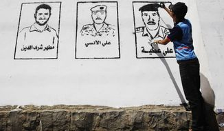 "A Yemeni graffiti artist paints faces of victims of the al-Qaida militant attack that occurred in the Defense ministry complex on Dec. 5, 2013, on a wall during an ""anti-terrorism"" campaign in Sanaa, Yemen, Thursday, March 6, 2014. Several Yemeni security officials recently said that al-Qaida has spread to operate in every province of the country of more than 25 million. Al-Qaida in the Arabian Peninsula, as the Yemen branch is known, has demonstrated its capabilities with a sophisticated and brutal attack in December on the Defense Ministry in the capital, Sanaa, that killed more than 50 people. (AP Photo/Hani Mohammed)"