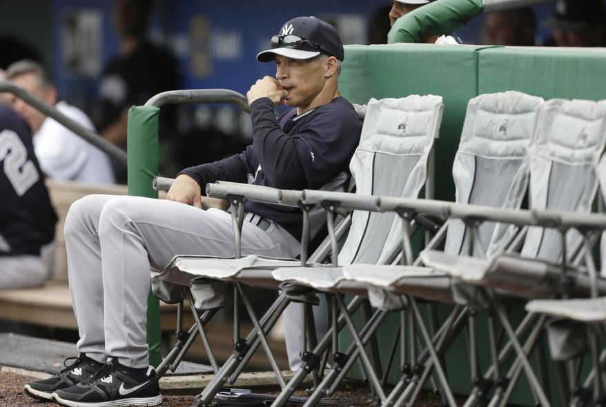 New York Yankees manager Joe Girardi sits outside the dugout during the second inning of an exhibition baseball game against the Philadelphia Phillies Thursday, March 6, 2014, in Clearwater, Fla. (AP Photo/Charlie Neibergall)
