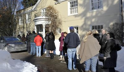 Lines of people wait to enter the Leonard home at the estate sale of the late novelist Elmore Leonard at his home in Bloomfield Township, Mich., Thursday, March 6, 2014. (AP Photo/The Detroit News, Charles V. Tines)
