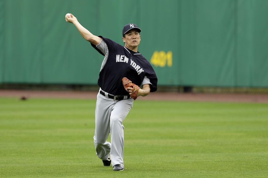 New York Yankees starting pitcher Masahiro Tanaka throws in the outfield before an exhibition baseball game against the Philadelphia Phillies, Thursday, March 6, 2014, in Clearwater, Fla. (AP Photo/Charlie Neibergall)