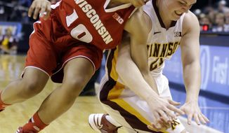 Wisconsin guard Dakota Whyte, left, and Minnesota guard Sari Noga go for a loose ball in the first half of an NCAA college basketball game in the opening round of the Big Ten Tournament in Indianapolis, Ind., Thursday, March 6, 2014. (AP Photo/Michael Conroy)