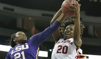 Alabama forward Ashley Williams (20) has her shot blocked by LSU forward Shanece McKinney (21) as she goes up for a basket in the first half of a second-round women's Southeastern Conference tournament NCAA college basketball game Thursday, March 6, 2014, in Duluth, Ga. (AP Photo/Jason Getz)