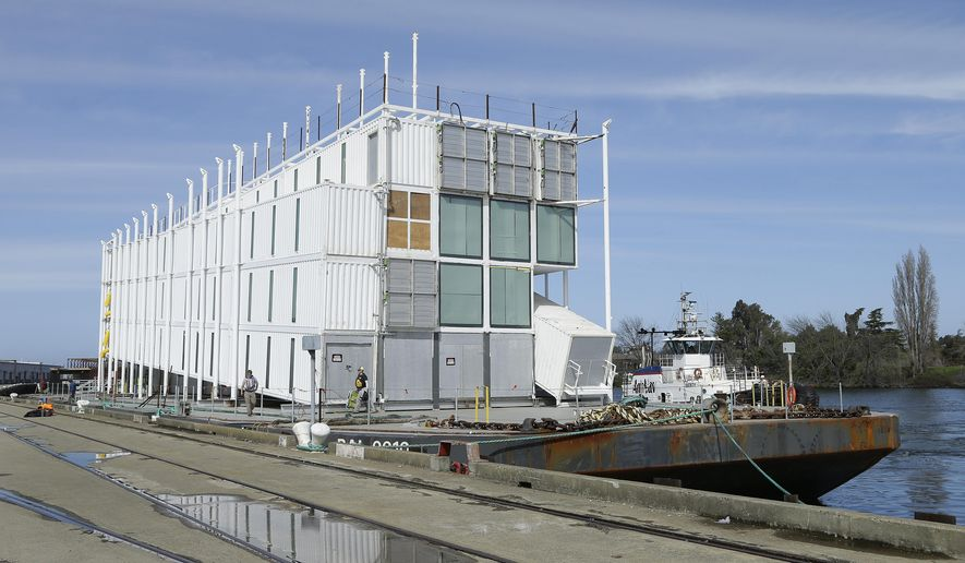 The Google barge is seen moored at the Port of Stockton Thursday, March 6, 2014, in Stockton, Calif.  Google's mystery barge has arrived at its new home in the California delta after the Internet company was ordered to move it from San Francisco. The odd-looking, four-story vessel made of recycled shipping containers departed from Treasure Island to comply with a Jan. 31 regulatory order concluding that Google Inc. didn't have the proper permits to build it there. Construction stopped on the project late last year. Google says the barge will serve as an interactive technology center when it's done. (AP Photo/Ben Margot)