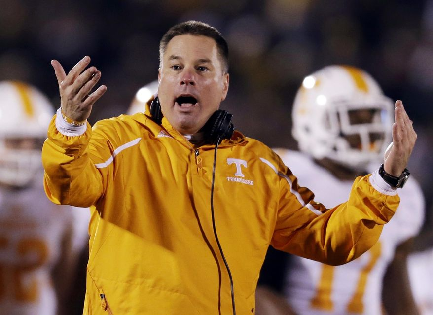 FILE - In this Nov. 2, 2013, file photo, Tennessee head coach Butch Jones yells on the sidelines during the first half of an NCAA college football game against Missouri in Columbia, Mo. Jones discusses the opening of a spring practice that features a four-way quarterback competition and the arrival of 14 early enrollees. The Volunteers hold their first spring workout Friday, March 7, 2014. (AP Photo/Jeff Roberson, File)