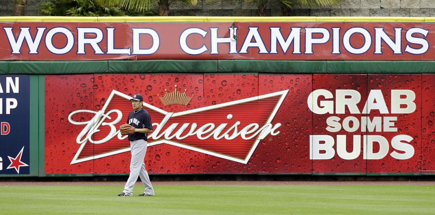 New York Yankees starting pitcher Masahiro Tanaka walks in the outfield before an exhibition baseball game against the Philadelphia Phillies, Thursday, March 6, 2014, in Clearwater, Fla. (AP Photo/Charlie Neibergall)