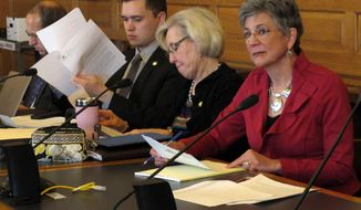Kansas Senate President Susan Wagle, right, a Wichita Republican, joins members of the Senate Judiciary Committee for a hearing on whether the state needs additional legal protections for people, groups and businesses opposing gay marriage, Thursday, March 6, 2014, at the Statehouse in Topeka, Kan. The other senators are, right to left, Pat Pettey, a Kansas City Democrat; Garrett Love, a Montezuma Republican, and Forrest Knox, an Altoona Republican. (AP Photo/John Hanna)