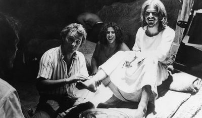 """FILE - In this Oct. 8, 1972 file photo, producer-director Norman Jewison, left, demonstrates how he wants an actor to wash the feet of Jesus, portrayed by Ted Neeley, during filming of the movie version of the Rock Musical, """"Jesus Christ Superstar,"""" in Bethlehem, Israel. (AP Photo, File)"""