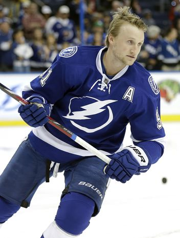 Tampa Bay Lightning center Steven Stamkos (91) skates during warm ups before an NHL hockey game Thursday, March 6, 2014, in Tampa, Fla. Stamkos will be playing his first game since breaking his right tibia on Nov. 11, 2013 in Boston. (AP Photo/Chris O'Meara)