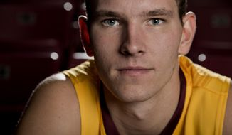 """In this Oct. 28, 2013, photo, Minnesota basketball player Oto Osenieks poses for a photo in Minneapolis. Osenieks will end his playing career a year early. The university announced Wednesday, March 5, 2014, it will seek an NCAA medical waiver to keep his scholarship from counting against the 13-player limit next season. Coach Richard Pitino said the knee injury that has kept Osieneks out of the last two games will """"limit his ability to continue playing"""" next season. (AP Photo/Star Tribune, Carlos Gonzalez) ST. PAUL OUT  MAGS OUT  MINNEAPOLIS-AREA TV OUT"""