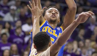UCLA's Kyle Anderson shoots over Washington's Nigel Williams-Goss in first half of an NCAA college basketball game on Thursday, March 6, 2014, in Seattle. (AP Photo/Stephen Brashear)