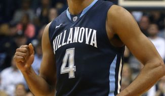 Villanova's Darrum Hilliard rpumps his fist near the close of an NCAA college basketball game against Xavier in Cincinnati on Thursday, March 6, 2014. Villanova won 77-70. (AP Photo/Tom Uhlman)
