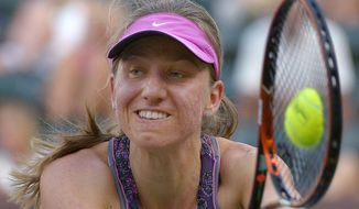 Mona Barthel, of Germany, returns a shot to Francesca Schiavone, of Italy, at the BNP Paribas Open tennis tournament, Thursday, March 6, 2014, in Indian Wells, Calif. (AP Photo/Mark J. Terrill)