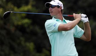 Belgium's Nicolas Colsaerts watches his drive from the sixth hole tee during the first round of the Puerto Rico Open PGA golf tournament in Rio Grande, Puerto Rico, Thursday, March 6, 2014. (AP Photo/Ricardo Arduengo)