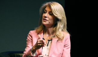 Democrat candidate for Texas governor Wendy Davis speaks at a live discussion with The Texas Tribune on Thursday, March 6, 2014 in Austin, Texas.  Davis will face Republican Greg Abbott.  (AP Photo/The Daily Texan, Jonathan Garza)
