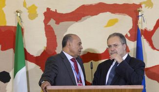 U.N. envoy to Libya Tarek Mitri, right, and Libya Foreign Minister Mohamed Abdulaziz share a word prior to meeting the media at the end of the Conference on International Support to Libya in Rome Thursday March 6, 2014.  (AP Photo/Alessandra Tarantino)