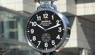 Shinola unveils one of the Shinola City Clocks at Cobo Center, March 7, 2014, in Detroit. The company is donating four clocks for display in the city. The clocks are inspired by city clocks that became popular fixtures on sidewalks of American cities in the 1800s. (AP Photo/Detroit News, Clarence Tabb Jr)  DETROIT FREE PRESS OUT; HUFFINGTON POST OUT; MANDATORY CREDIT