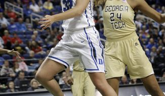 Duke's Tricia Liston (32) drives past Georgia Tech's Shayla Bivins (24) during the first half of an NCAA college basketball game at the Atlantic Coast Conference tournament in Greensboro, N.C., Friday, March 7, 2014. (AP Photo/Chuck Burton)