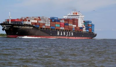 FILE - In this July 18, 2013 file photo, a container ship makes its way into the Port of Charleston in Charleston, S.C. A spokeswoman for the South Carolina Ports Authority said Friday, March 7, 2014, that the authority expects a seemless transition from studies of deepening the harbor shipping channel to dredging work on the $350 million project expected to begin late next year. (AP Photo/Bruce Smith, File)