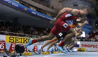 United States' Ashton Eaton starts the 60m hurdles race of the men's heptathlon during the Athletics Indoor World Championships in Sopot, Poland, Friday, March 7, 2014.  (AP Photo/Matt Dunham)