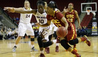 Southern California's guard Ariya Crook, front right, drives around Arizona State's Promise Amukamara (10) in the second half of an NCAA college basketball game in the second round of the Pac-12 women's tournament on Friday, March 7, 2014, in Seattle. USC won 59-57. (AP Photo/Ted S. Warren)