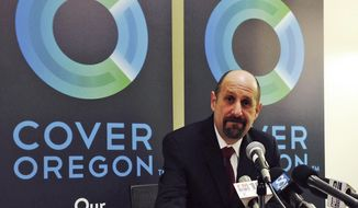 FILE - This Dec. 10, 2013, file photo shows Dr. Bruce Goldberg, acting head of Oregon's troubled health insurance exchange, at a news conference at Cover Oregon headquarters in Durham, Ore. More than five months after Oregon's botched health-insurance exchange failed to go live, concern is mounting for another, less visible state IT project that was built in conjunction with the exchange, using the same technology. Officials say they are about to launch a formal review of the so-called modernization program, a multimillion-dollar Department of Human Services project meant to improve online access to public benefits, to see if it hides serious flaws similar to those of the Cover Oregon exchange. (AP Photo/Gosia Wozniacka, File)