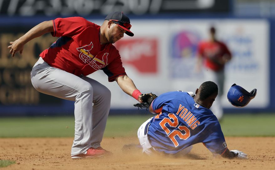 New York Mets' Eric Young Jr., right, is tagged out by St. Louis Cardinals shortstop Jhonny Peralta on a stolen base attempt to end the third inning of an exhibition spring training baseball game Friday, March 7, 2014, in Port St. Lucie, Fla. (AP Photo/Jeff Roberson)